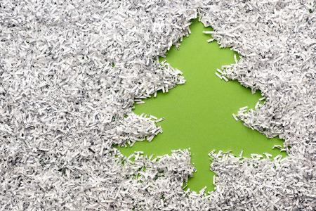 green fir tree made from background under shredded paper heap