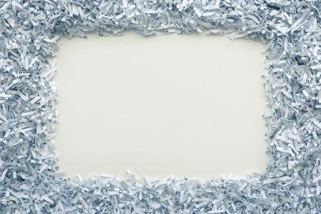 white background with shredded paper frame around