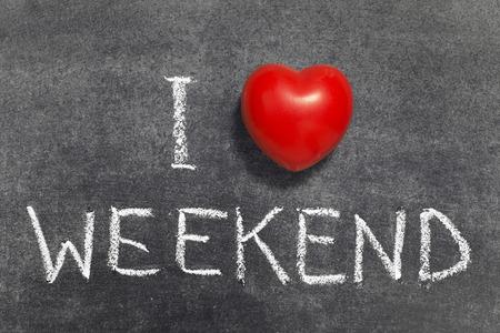 I love weekend phrase handwritten on blackboard with red heart symbol Фото со стока - 32499273