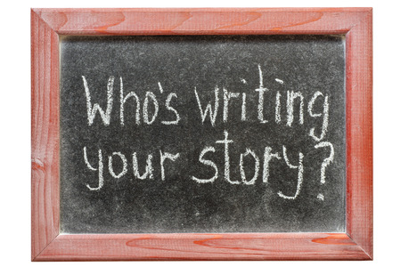 who's writing your story question handwritten on framed blackboard