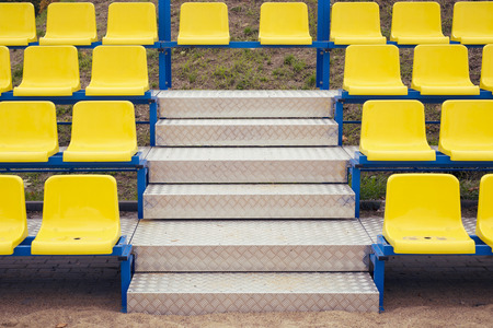 metallic stairs: metallic stairs between yellow seats