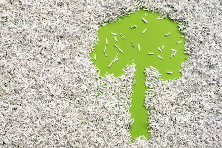 recycle tree: green tree made from background under shredded paper heap Stock Photo