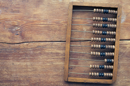 old abacus on the vintage wooden table top