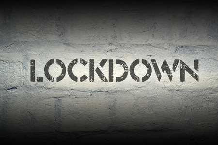 lockdown: lockdown stencil print on the grunge white brick wall
