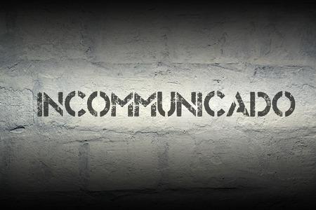incommunicado stencil print on the grunge white brick wall