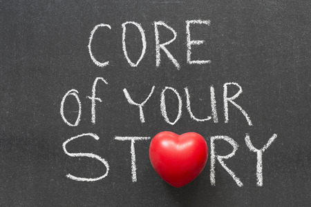 phrase: core of your story phrase handwritten on blackboard with heart symbol instead of O Stock Photo