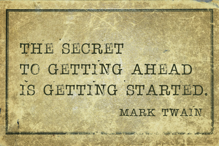 yellowish green: secret of getting ahead - famous Mark Twain quote printed on grunge vintage cardboard