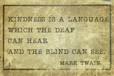 twain: Kindness is a language - famous Mark Twain quote printed on grunge vintage cardboard Stock Photo