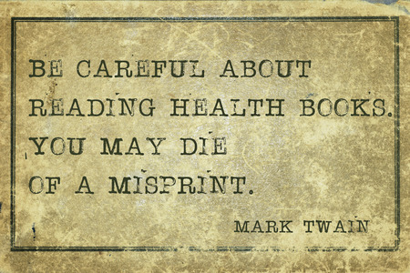 twain: you may die of a misprint - famous Mark Twain quote printed on grunge vintage cardboard Stock Photo