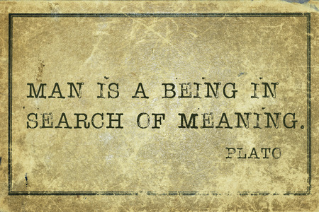 plato: Man is a being in search of meaning - ancient Greek philosopher Plato quote printed on grunge vintage cardboard