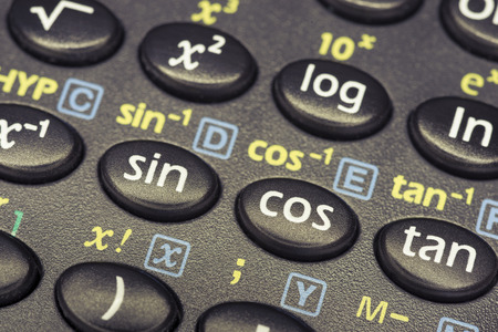 tangent: trigonometry functions push buttons of scientific calculator with focus on cos button