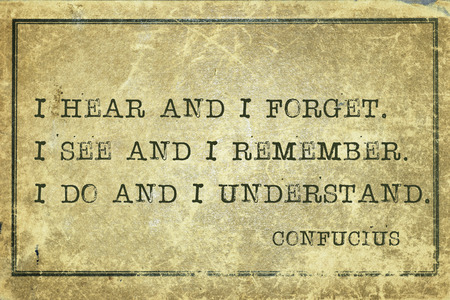I hear and I forget - ancient Chinese philosopher Confucius quote printed on grunge vintage cardboard