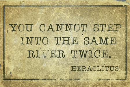 twice: You cannot step into the same river twice - ancient Greek philosopher Heraclitus quote printed on grunge vintage cardboard Stock Photo