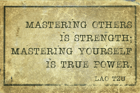 yellowish green: mastering others is strength - ancient Chinese philosopher Lao Tzu quote printed on grunge vintage cardboard