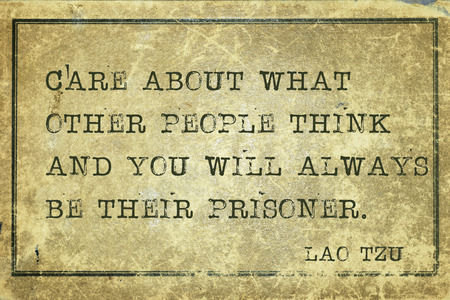 yellowish green: care about what other people think - ancient Chinese philosopher Lao Tzu quote printed on grunge vintage cardboard Stock Photo