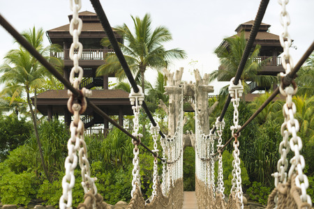 hanged: hanged rope-way leading to the observation towers at the famous Sentosa island in Singapore with focus on bridge