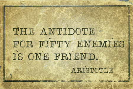 antidote: the antidote for fifty enemies - ancient Greek philosopher Aristotle quote printed on grunge vintage cardboard Stock Photo