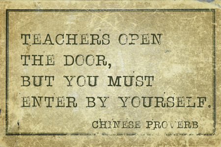 proverb: Teachers open the door - ancient Chinese proverb printed on grunge vintage cardboard Stock Photo