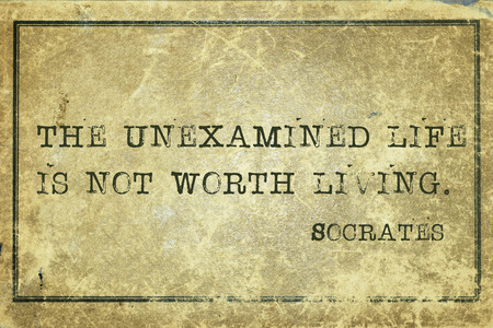 ancient philosophy: The unexamined life is not worth living- ancient Greek philosopher Socrates quote printed on grunge vintage cardboard