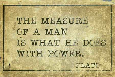 plato: the measure of a man - ancient Greek philosopher Plato quote printed on grunge vintage cardboard