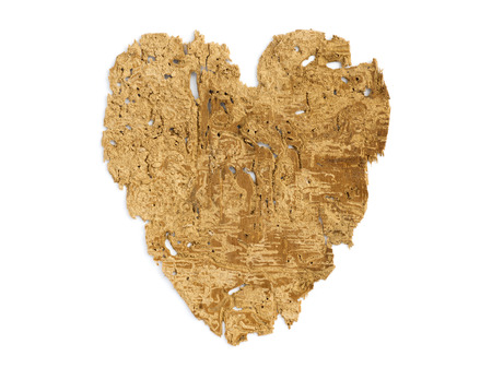 heart figure made from ancient detailed wooden sheet eaten by worms and bugs