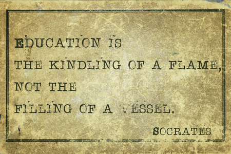 ancient philosophy: Education is the kindling of a flame - ancient Greek philosopher Socrates quote printed on grunge vintage cardboard