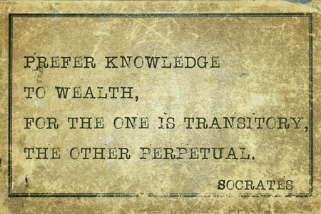 prefer: Prefer knowledge to wealth - ancient Greek philosopher Socrates quote printed on grunge vintage cardboard Stock Photo