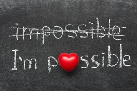 interpretation: I am possible concept handwritten on blackboard with heart symbol instead of O