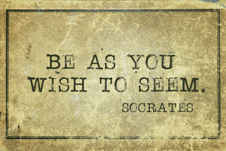 yellowish green: Be as you wish to seem - ancient Greek philosopher Socrates quote printed on grunge vintage cardboard Stock Photo