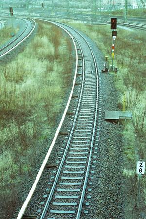 sleepers: autumnal rainy landscape with railway track Stock Photo