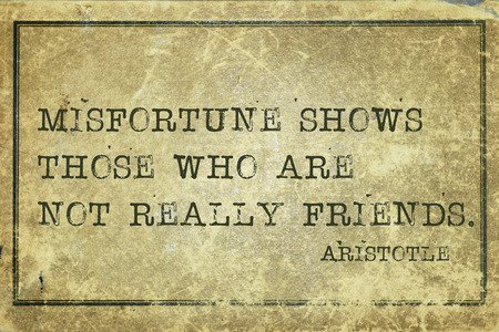 ancient philosophy: Misfortune shows those who are not really friends - ancient Greek philosopher Aristotle quote printed on grunge vintage cardboard