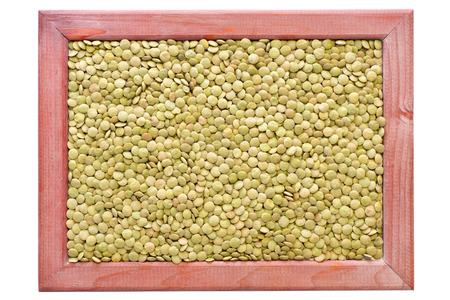 green lentil: green lentil beans background in red wooden frame