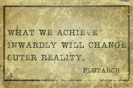 inwardly: What we achieve inwardly - ancient Greek philosopher Plutarch quote printed on grunge vintage cardboard Stock Photo