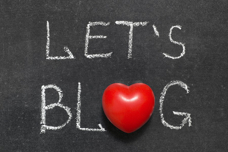 virtual community: lets Blog phrase handwritten on blackboard with heart symbol instead of O