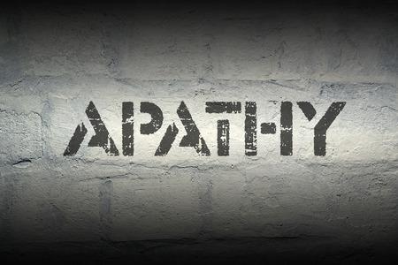 apathy: apathy stencil print on the grunge white brick wall