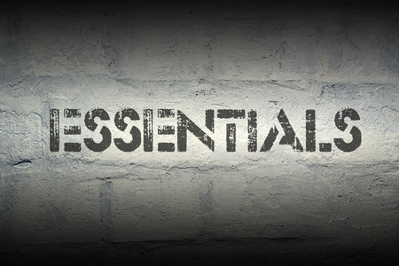 substantial: essentials stencil print on the grunge white brick wall