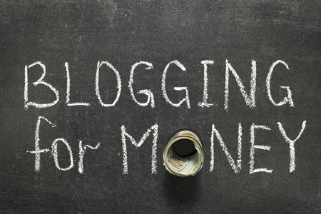 money roll: blogging for money phrase handwritten on blackboard with money roll instead of O