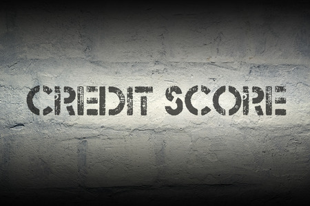 credit score: credit score stencil print on the grunge white brick wall