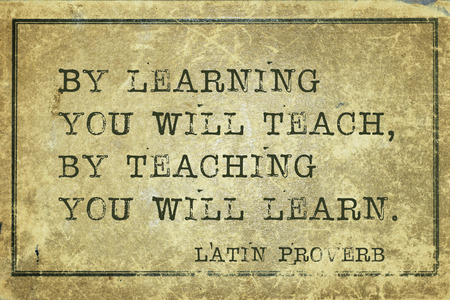 By learning you will teach, by teaching you will learn - ancient Latin proverb printed on grunge vintage cardboard