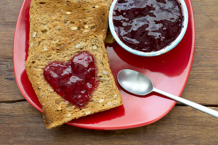 fried toasts and jam on the red plate