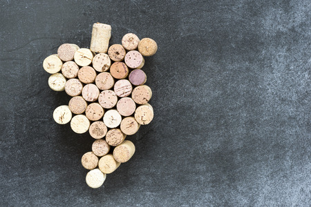smudged: grape bunch made from many wine corks on smudged chalkboard