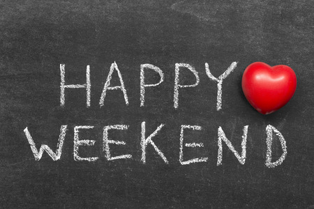 happy weekend phrase handwritten on blackboard with heart symbol Фото со стока - 38327777