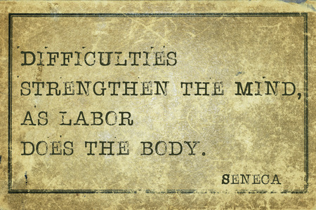 seneca: Difficulties strengthen the mind - ancient Roman philosopher Seneca quote printed on grunge vintage cardboard