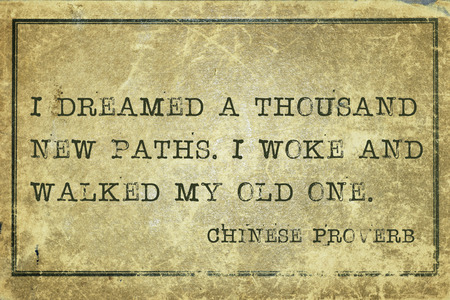 I dreamed a thousand new paths - ancient Chinese proverb printed on grunge vintage cardboard Stock Photo