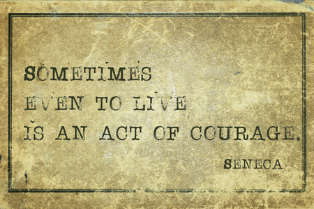 seneca: Sometimes even to live is an act of courage - ancient Roman philosopher Seneca quote printed on grunge vintage cardboard