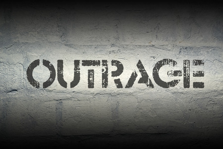 deformity: outrage stencil print on the grunge white brick wall