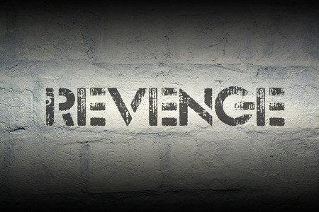 revenge: revenge stencil print on the grunge white brick wall Stock Photo