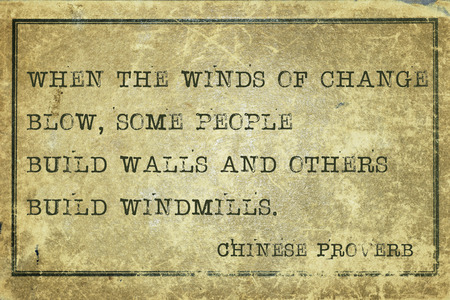 ancient philosophy: When the winds of change blow - ancient Chinese proverb printed on grunge vintage cardboard