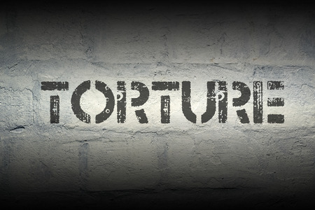 torture: torture stencil print on the grunge white brick wall