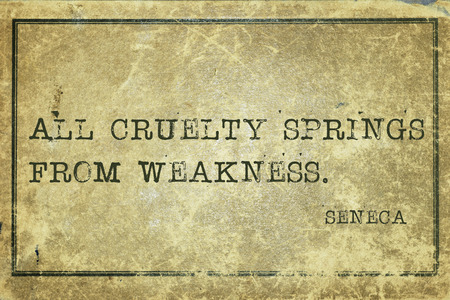 seneca: All cruelty springs from weakness - ancient Roman philosopher Seneca quote printed on grunge vintage cardboard